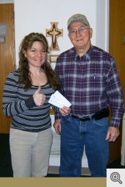 Amanda Maness accepting checks from Gerald Krawczynski