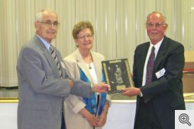 Marvin and Lucy Young receiving award from Bill Roe