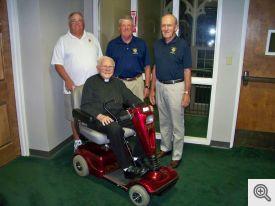 Standing behind Monsignor (l-r): Dan Murphy, Scott Krantz, and Bob Honzik.
