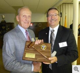 Grand Knight Bob Honzik (l) receives a plaque from his successor Gary Wolfer.