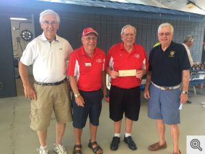 Presenting the Knights of Columbus donation to their scholarship fund were (left to right) Milt Spaniel, Jack Barry, Bill Veal and Walter Free.